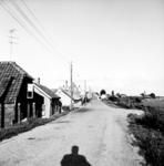 19-1625 Straatgezicht met electriciteitspalen